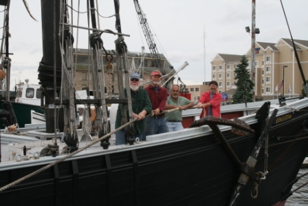 Marty, Fred Sterner, DCR carpenter Manny Silva and Leon adjusted the docklines.
