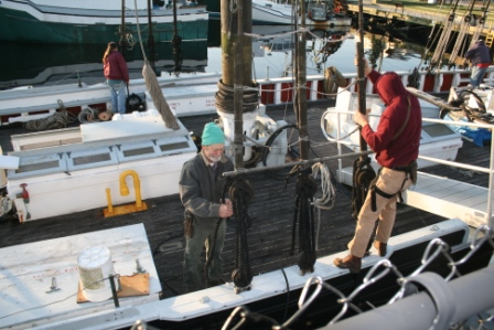 Once Steve in on the deck, he and Fred Sterner loosen the starboard shroud lanyards while Leon Poindexter works on the port.