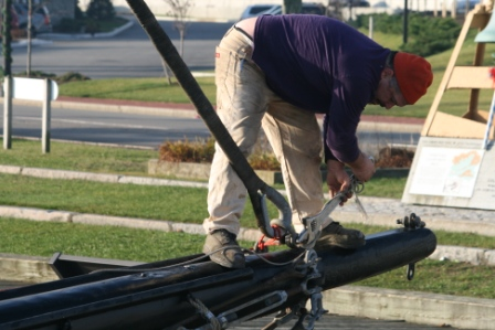 Once the main mast was set the crew started on the foremast.  Here Willi loosens the jib stay shackle.