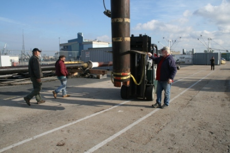 Once again straps were secured to the mast so the forklift could maneuver