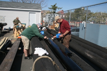 Meanwhile Commissioner Fred Sterner and volunteer (former crew) Katie DePrato were oiling the spars up on the pier
