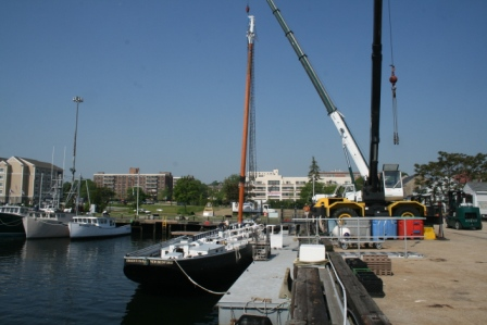 The new fore mast is lowered to Ernestina.  From a life in the forests of the Olympic Peninsula of WA to Massachusetts Official Tall Ship!