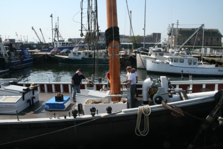 The fore mast is through the deck, next through the table and fo'c'sle sole and into the step