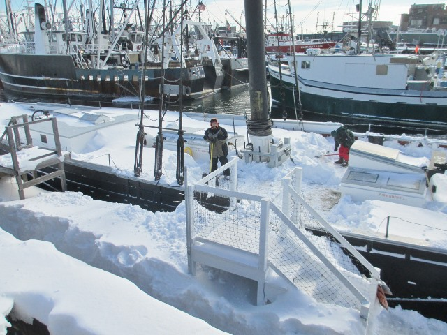 The first task for Paul and David was to shovel a path along the floating dock,