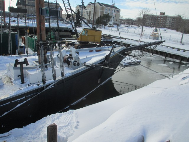 There is a lot of snow to be removed before it settles and solidifies.  The deck has to be clear to safely move the ship to Maine.  Thank you, Paul and David!  And thank you DCR for making Ernestina-Morrissey a priority!