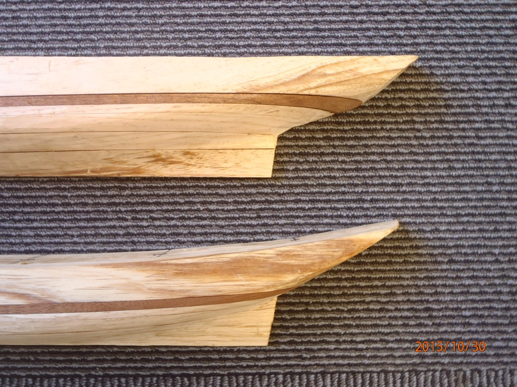 "Close up of the sterns of two half models, crafted by Harold A. Burnham, showing the planned shear of the Ernestina-Morrissey. You can see a clear comparison of ""before (top) and after (bottom)"" The stern will be restored during the work the ship is undergoing now at Boothbay Harbor Shipyard"