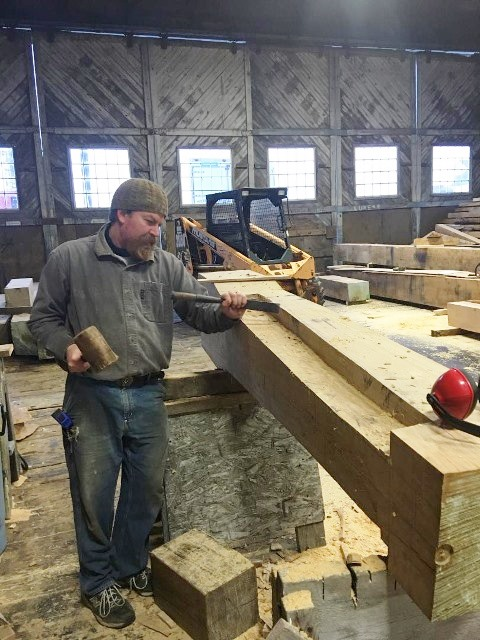 Ross cutting the rabbet into the sternpost  credit H.Burnham