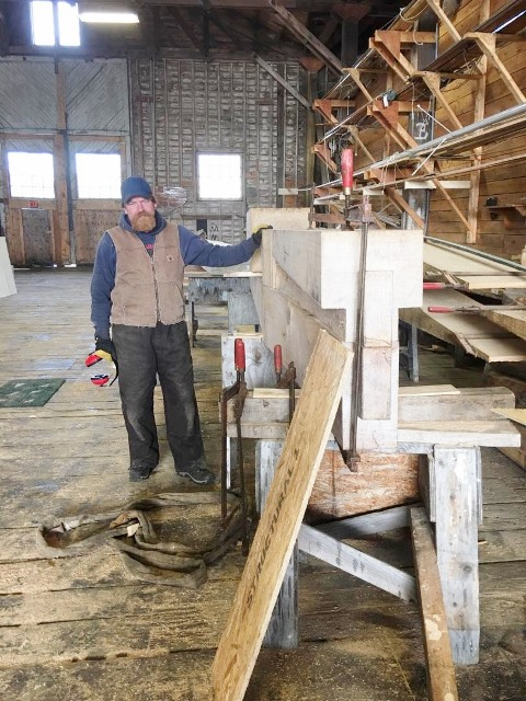 Ross working on the sternpost. Note the rabbet cut and tenon on the bottom. credit H.Burnham