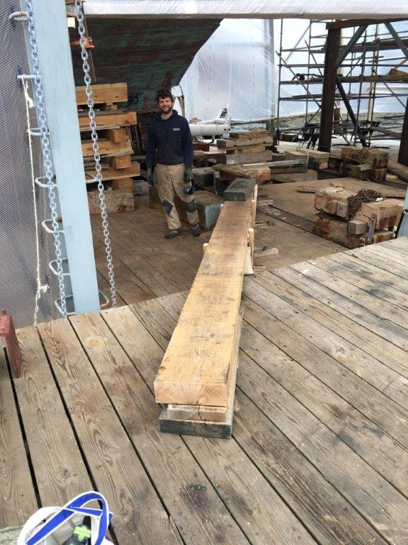The shipyard crew is constructing a ramp system to bring the keel in place under the ship.