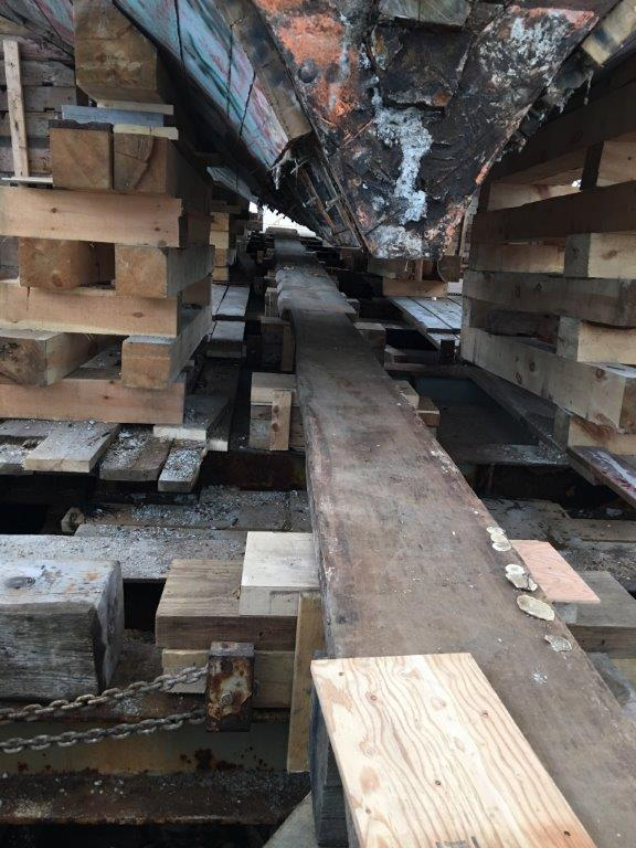 This is looking forward and shows where the pine keel was removed and the structure that has been readied to receive the new keel.