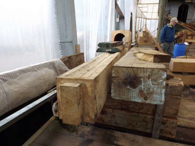 Rudder post on the left, with the tenon that will fit into the mortise in the keel. The passage for the rudder shaft will inside the hull.
