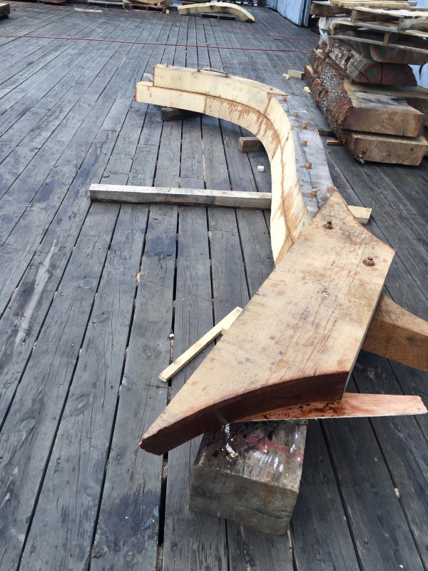 This is a cant frame and there is a floor across the bottom of it that will be bolted to the forward face of the stern post.  He floor is bolted to the after futtocks with 3/4 bronze bolts.  photo credit: H. Burnham