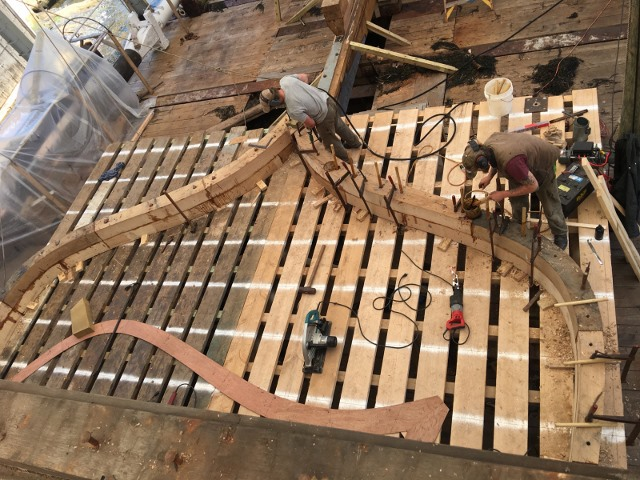 The larger frames forrard are being assembled close to their place in the ship's structure.  This frame will be at teh break in the deck, about mid-ships.   credit H.Burnham