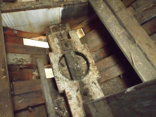 The fore mast step.  This would carry the mast that came up through the aft end of the galley table.