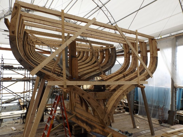Straps on the trunnel stubs hold the port and starboard sections in place.