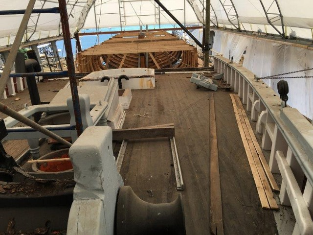 Looking from the deck of the forward section near the windlass aft to the new framing and bracing.