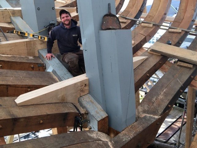 Meanwhile, the floor timbers are being fitted to the cant frames at the stern.