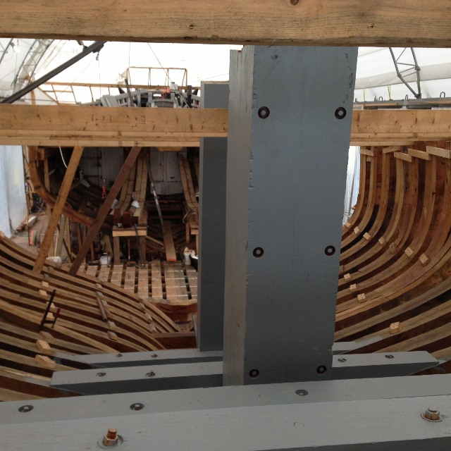 The floors have been fastened to the cant frames and you can see the stern post forward of the rudder post.