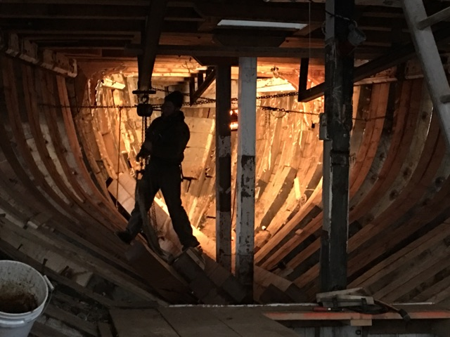 The frames forward to the stem will stay in place.  The new frames are easy to notice.  The vertical beams support the deck with the bulkheads and steel I beam gone.  credit Harold Burnham