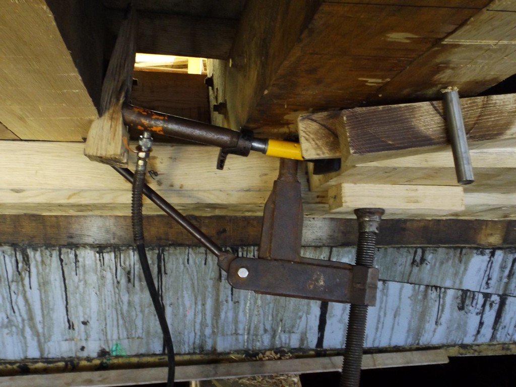 Hydraulics are again called into service along with classic wedges at insure the plank is tight to the stern post.