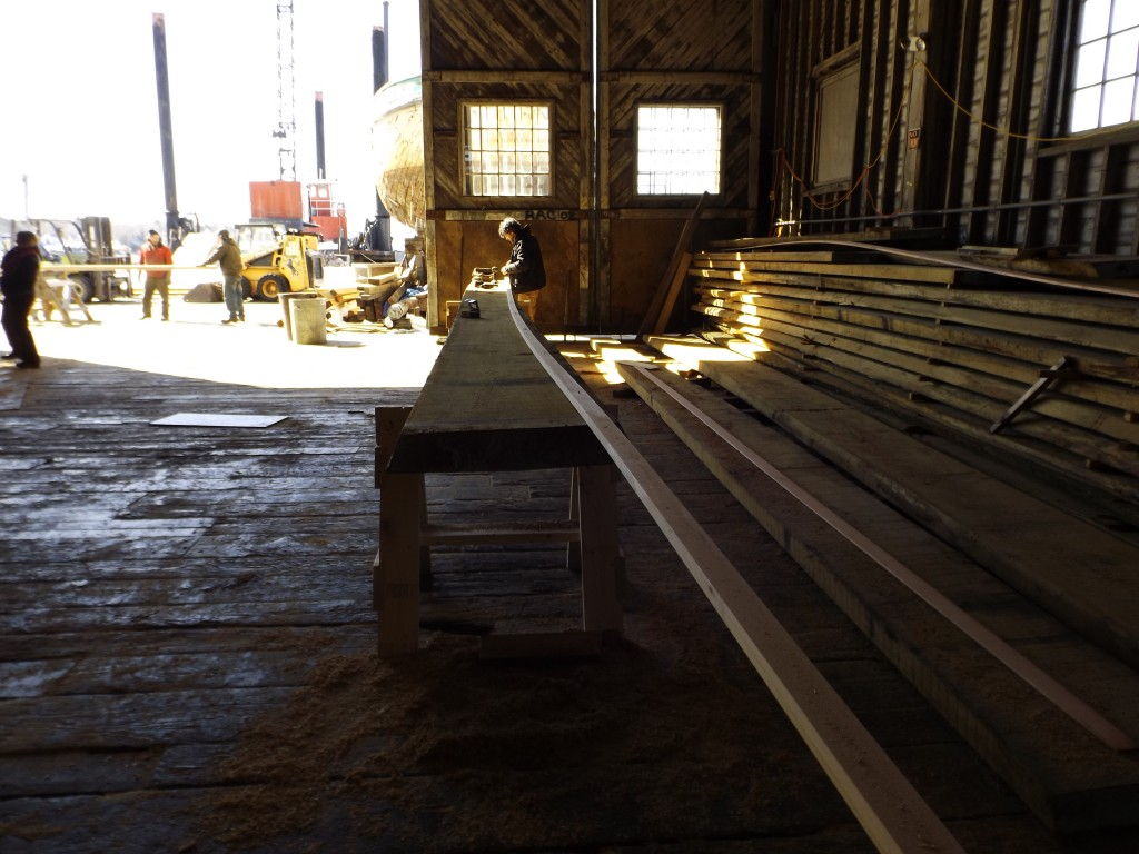 A spiling batten is used to scribe the line that needs to be cut in the plank.