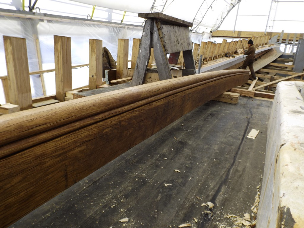 The new beam, with a carved bull-nose, is ready to be fitted into place.