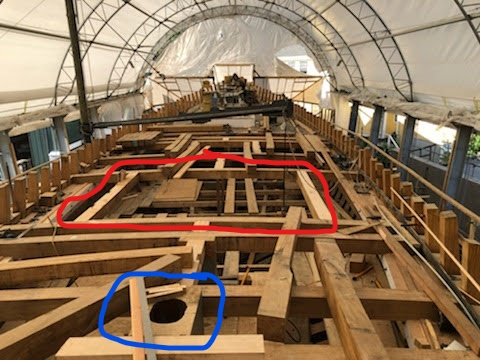 The red line surrounds the frame left open for the aft cabin trunk.  The blue line surrounds the rudder post with the passage for the steering linkage from the steering gear to the rudder.