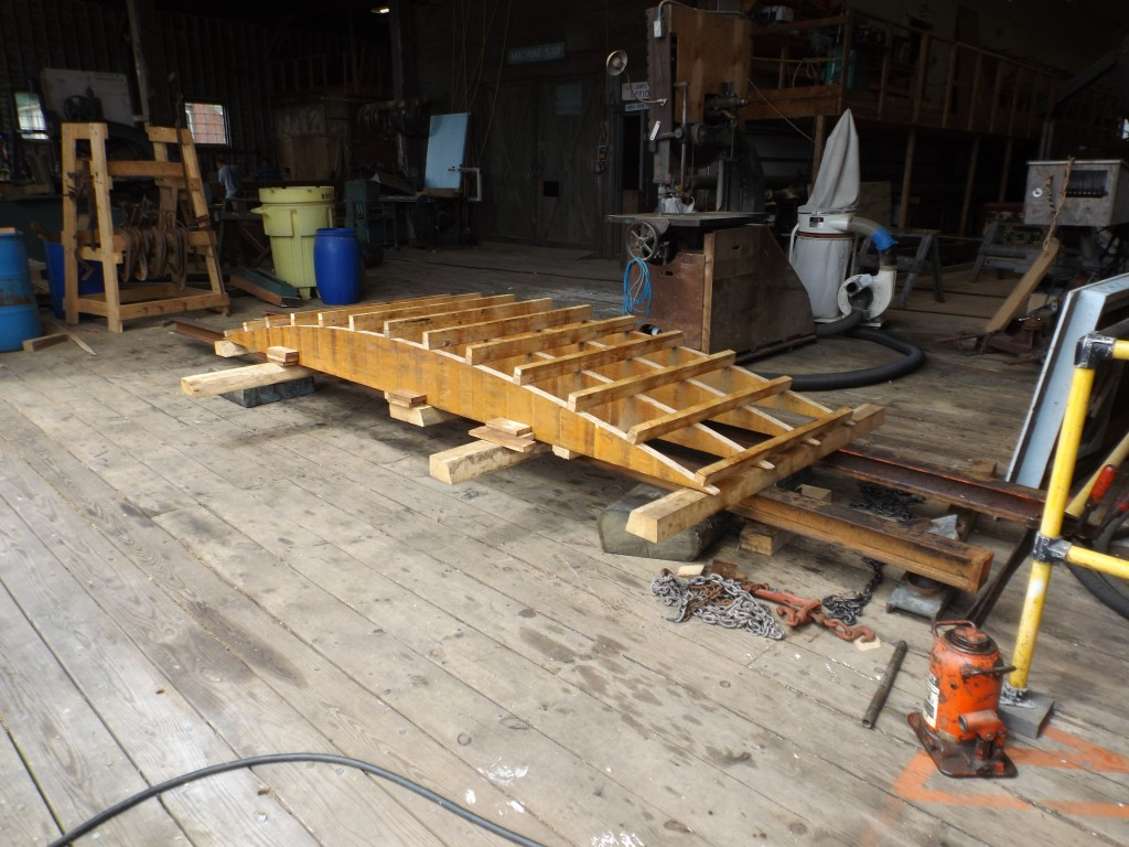 This form will be used to bend the planks to fit the transom frame.  Notice the steel I-beams that support the frame and will give a strong structure to fasten the clamps to.