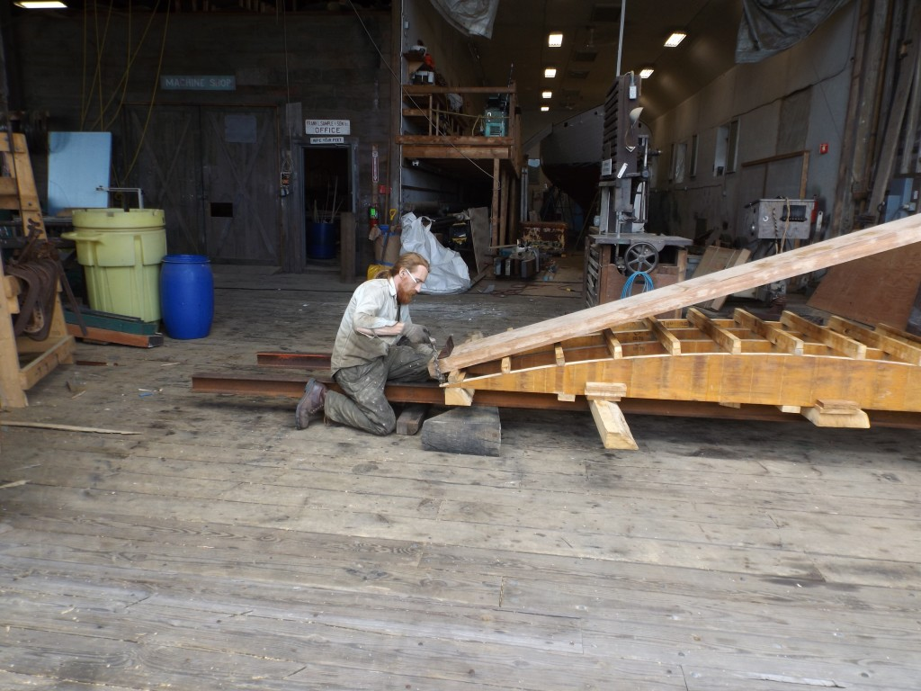 The process starts with a chain and a lenth of angle iron so the chain will not scar the edges of the plank.  This will hold the end of the plank to the form.