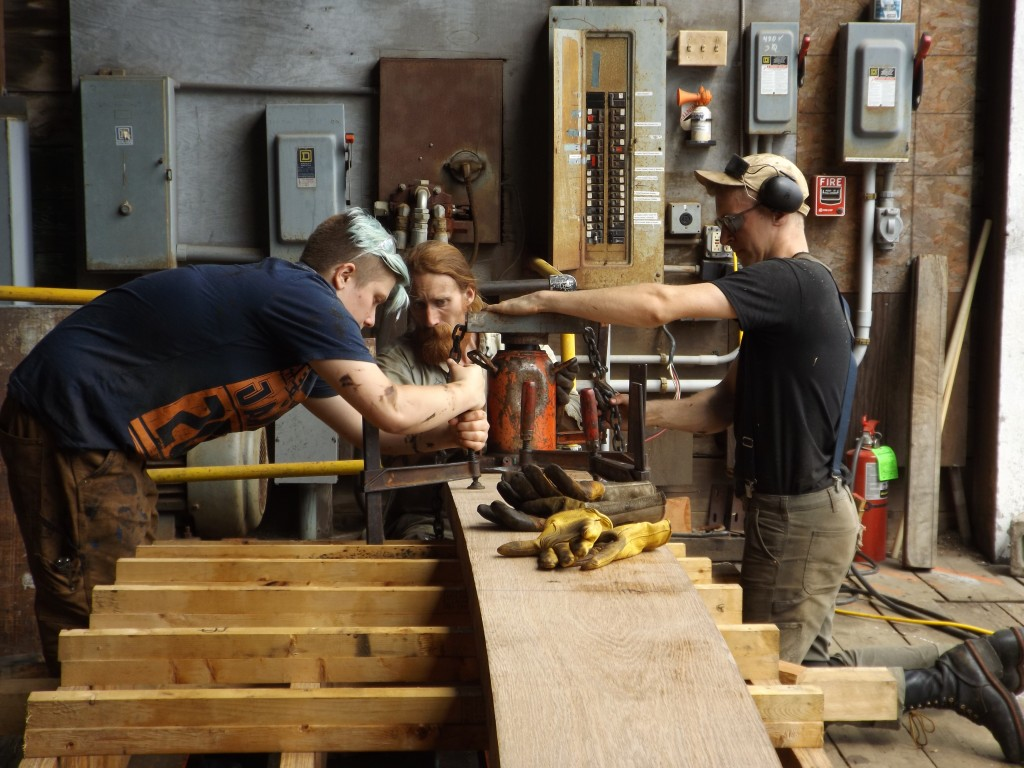 More clamps are added as the plank gets closer to the form.