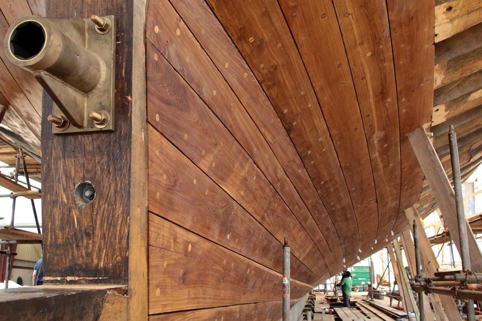 From the stern, lower planks faired, oiled and the calking is progressing