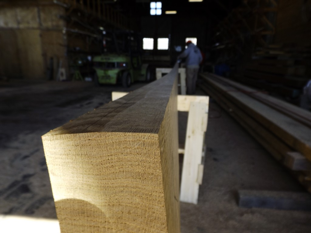 Once the plank is shaped and planed, shaping a caulking bevel is the last preparation before heading to the steam box.  David Short uses a planer to bring the bevel to the pencil line. The bevel will allow space for the oakum and cotton caulking.