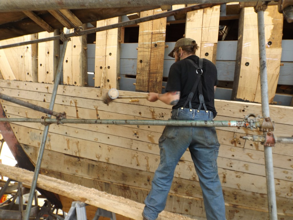 Once the plank is clamped tightly in place the trunnels can be pounded in.
