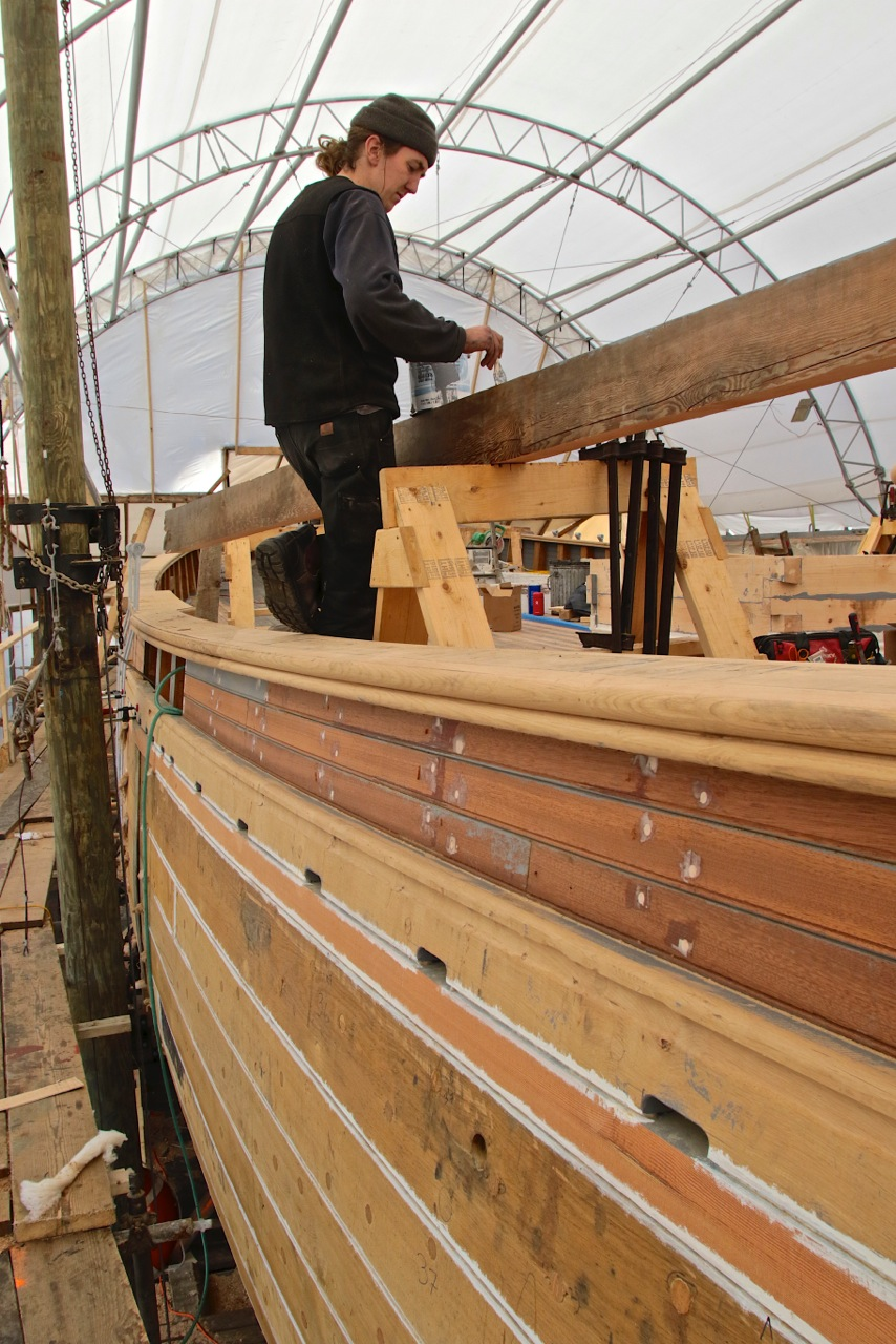 The beautifully and traditionally detailed cap rail tops the bulwarks. The scuppers are at deck level. These details will show her restored sheer here on the port side, aft. credit Robert Mitchell