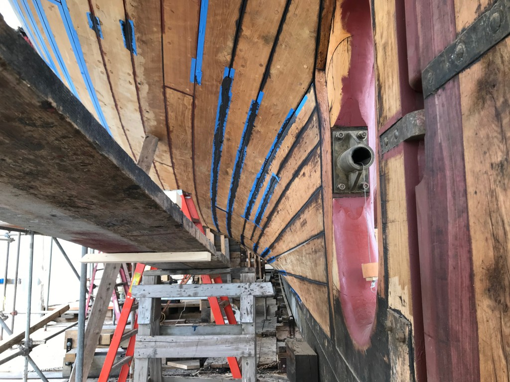 """This is an earlier photo showing the final caulking,  for a """"before and after"""" port side. credit Dave Thompson"""