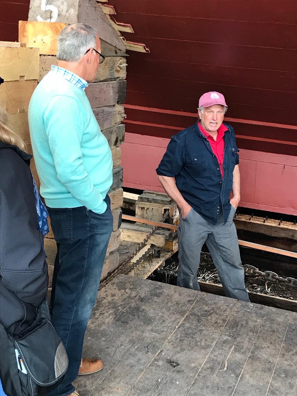 Captain Harold Burnham explained the work, here with Bob Hildreth. credit John Bullard