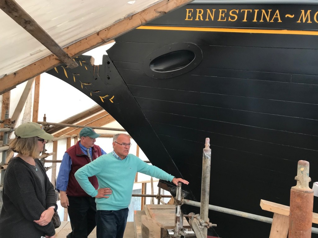 Wendy Pearl, Leo Roy and Bob Hildreth at the bow with Ernestina-Morrissey inscribed above. credit John Bullard