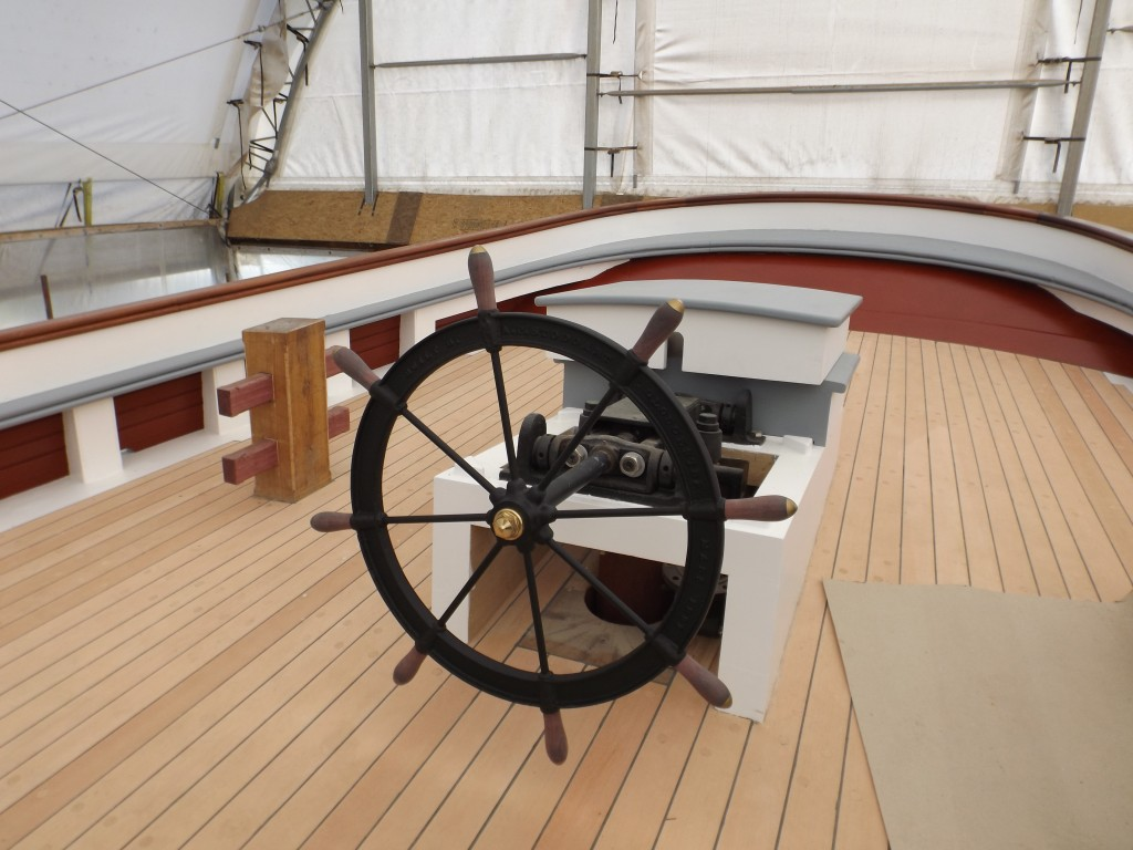 The new aft deck and stern rail with the refurbished original wheel.