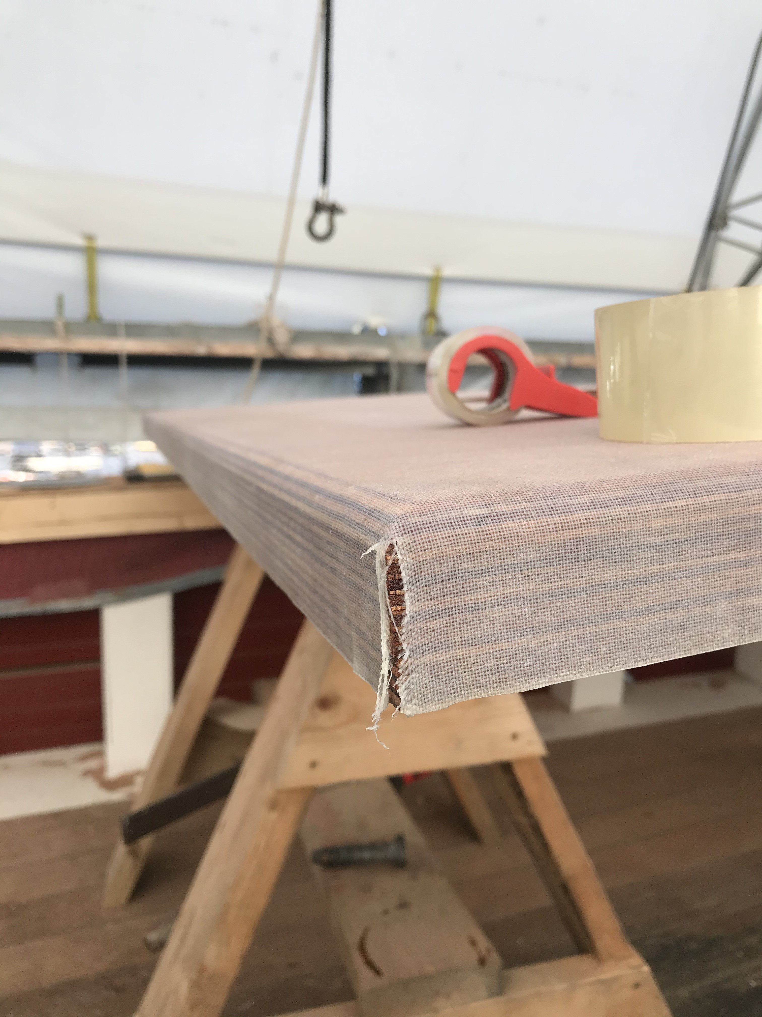 The Fish Hold cabin top receiving a thin layer of dynel and epoxy to seal and protect the wood for many years to come.