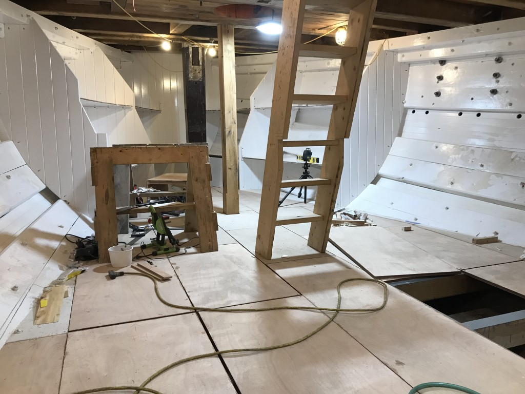 The crew is excited to be fitting out the forward cabin.  This space will be a busy area of the ship, where the galley and crew mess are set to be located.  You can see the bunks and partitions being painted as we work our way aft through the space.