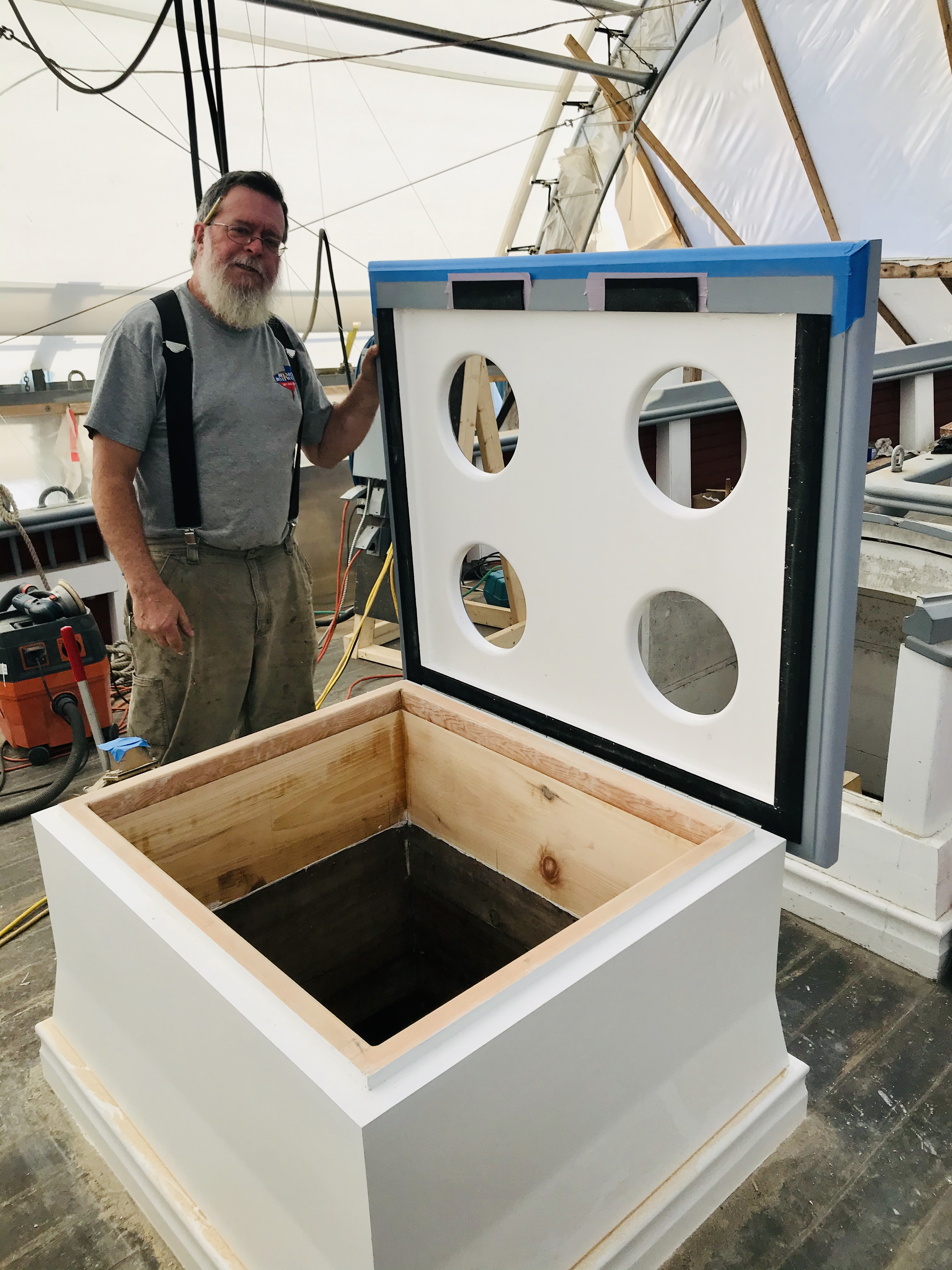 Lead Shipwright David Short showing off the newly refurbished Galley Hatch.