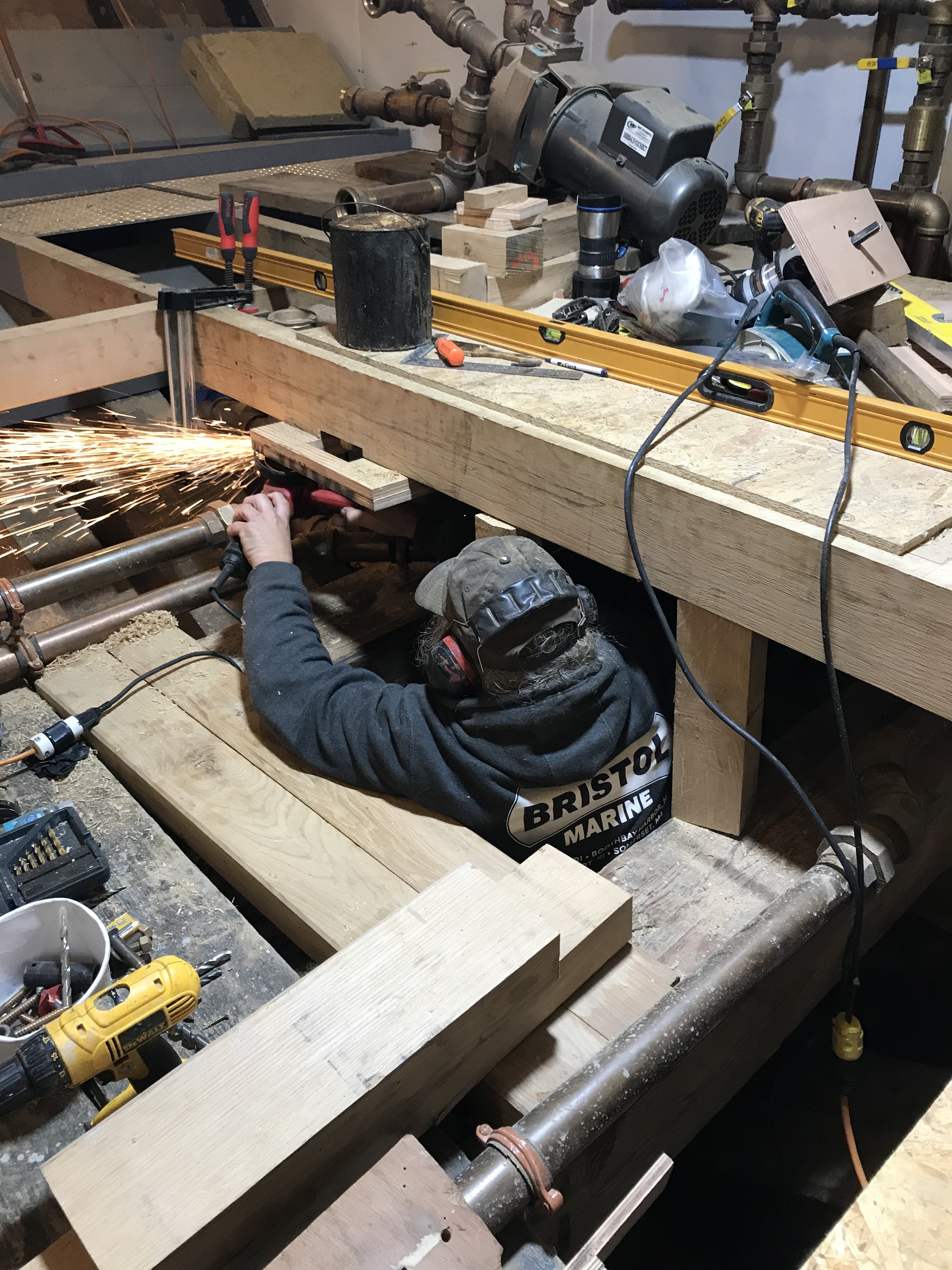 Tom Gearharrt can be seen cutting a pipe hanger in the engine room to make space for additional floor beams.  All of the high-volume plumbing on the ship is high quality red-brass.