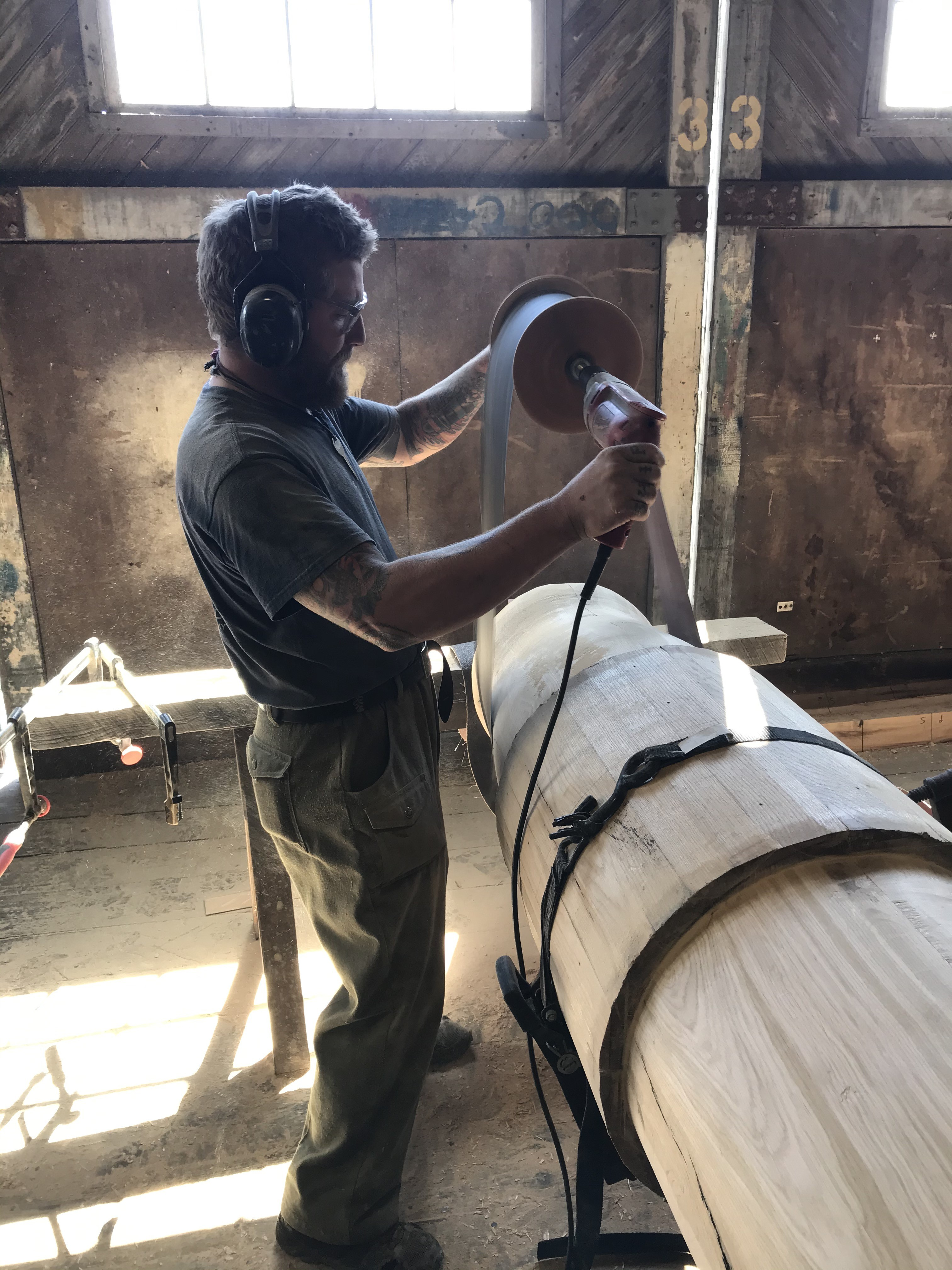 One of our shipwrights carefully sands and shapes the new windlass.  This piece was built to mimic the same windlass that arrived with the ship, and will be a functional replica of centuries-old technology.