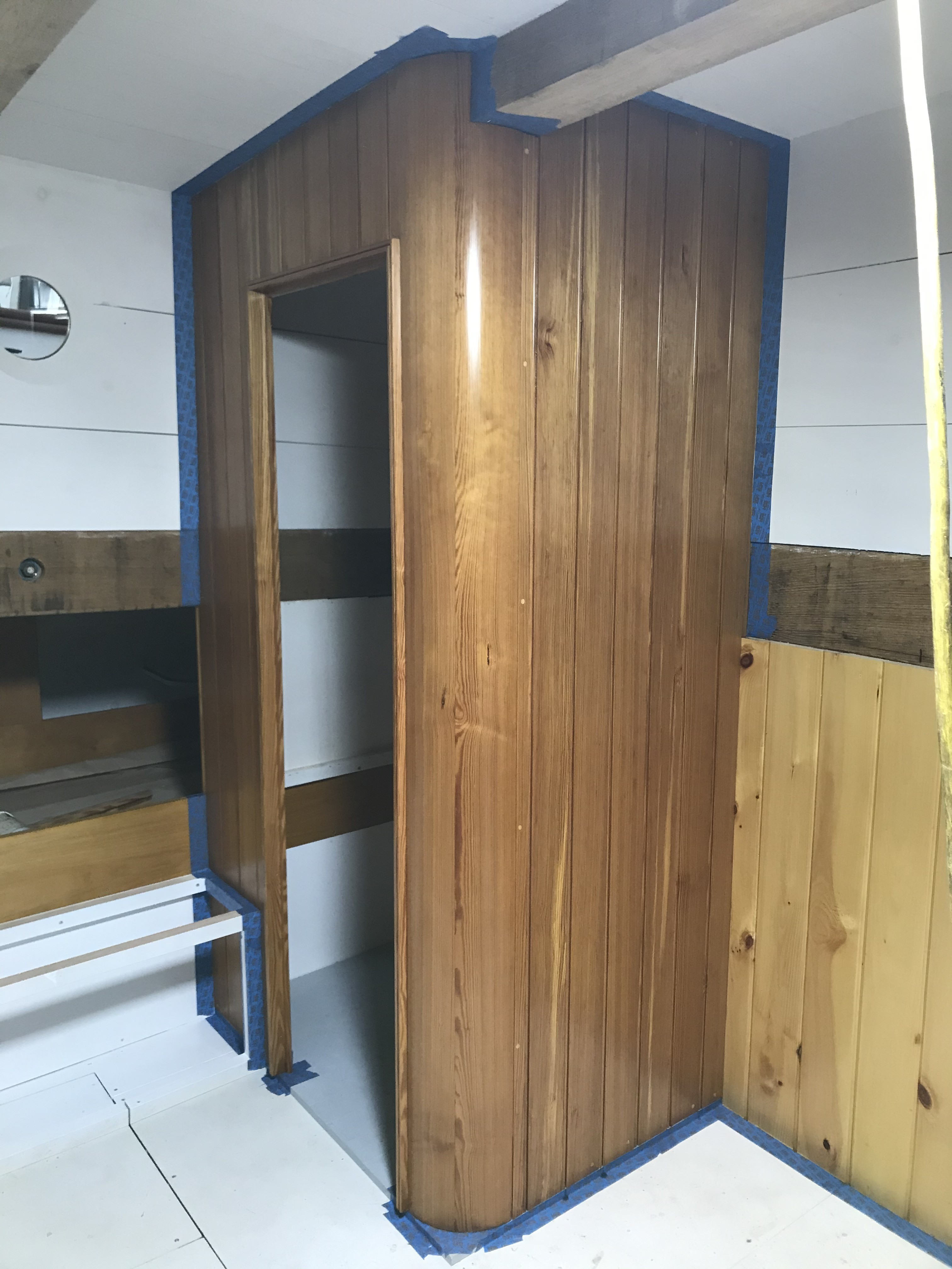 The Aft Cabin continues to come together.  This image shows the first coat of polyurethane applied to the beautifully constructed head enclosure.  Next week, we expect to see the custom louvered door hung in place to complete the installation.