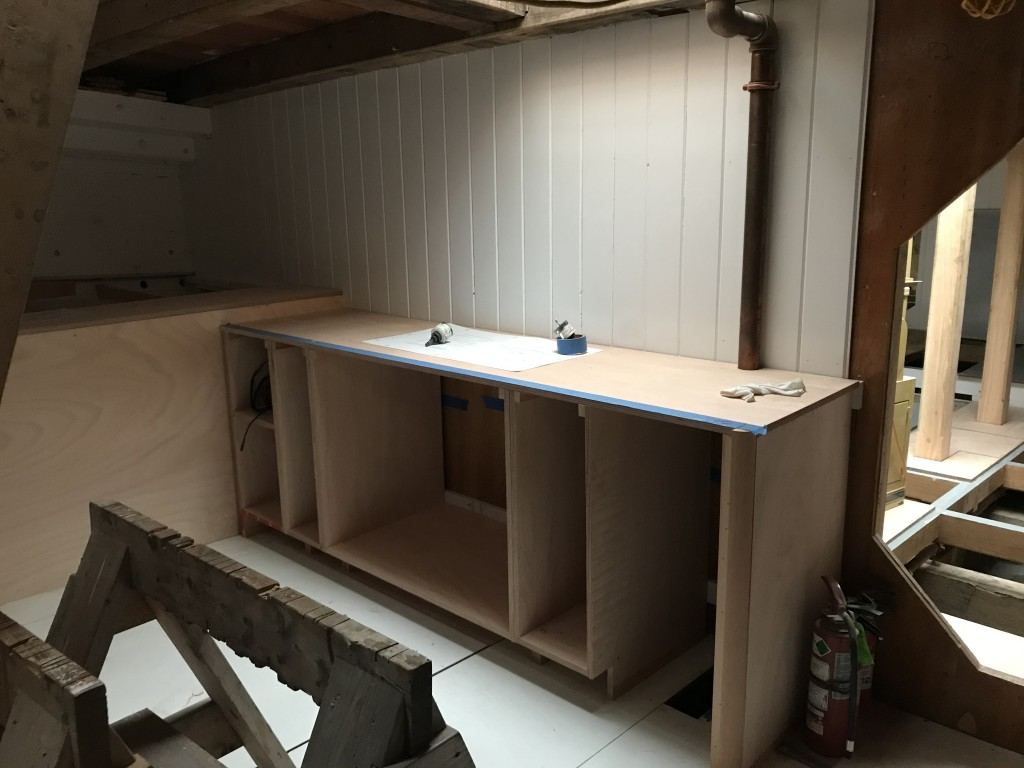 This image shows our continued progress in the Foc'sle.  David Short, our lead shipwright has been busy framing out the structure for what will become the galley on Ernestina-Morrissey.  Along the bulkhead will be the sink station and food preparation counter space.  Outboard will be another counter space with a large freezer compartment beneath.