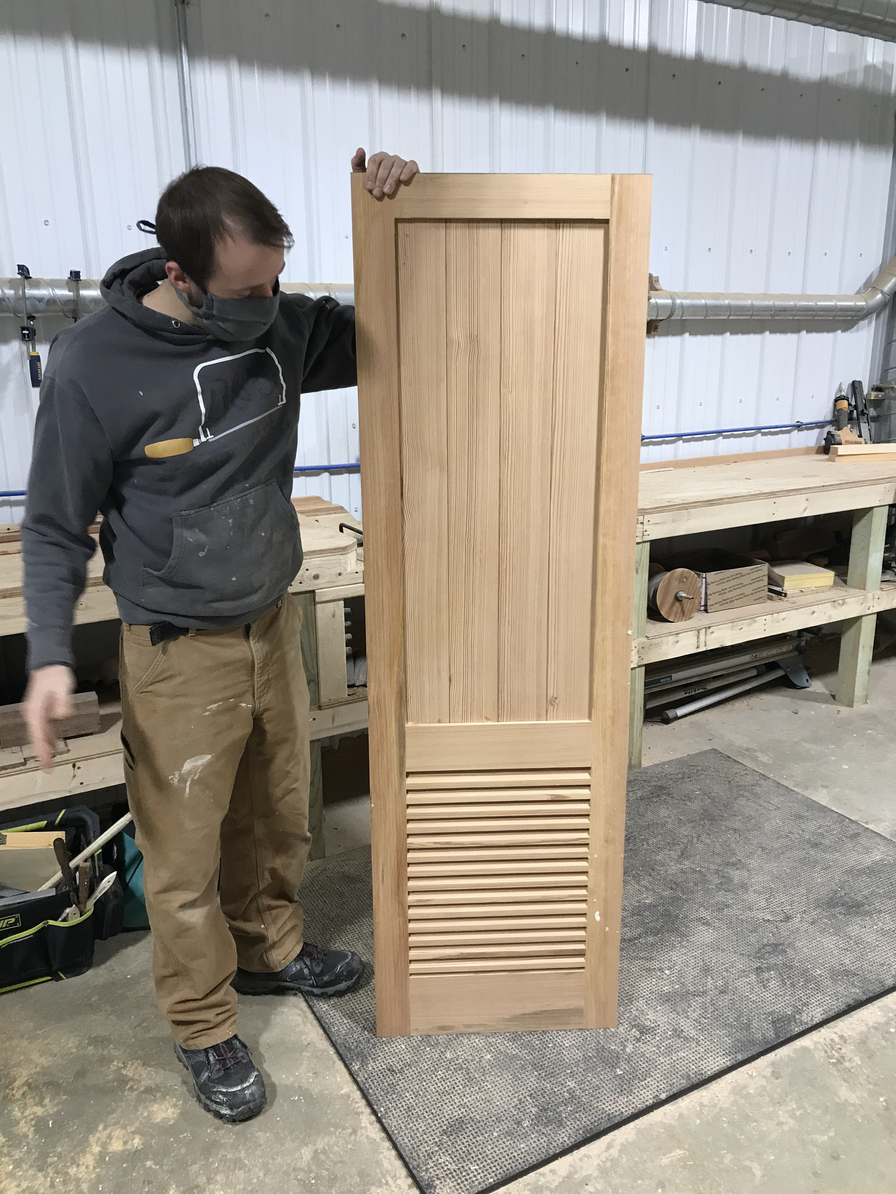 This image shows one of our newest carpenters Kazimieras, who joined a few short months ago.  He has been the man behind the head compartment installation in the Aft Cabin.  Here he is showing off his most recent craftsmanship.  This door will complete the head compartment project.  It is currently in the paint booth being varnished before installation.  We are all excited to see it hung in place next week.