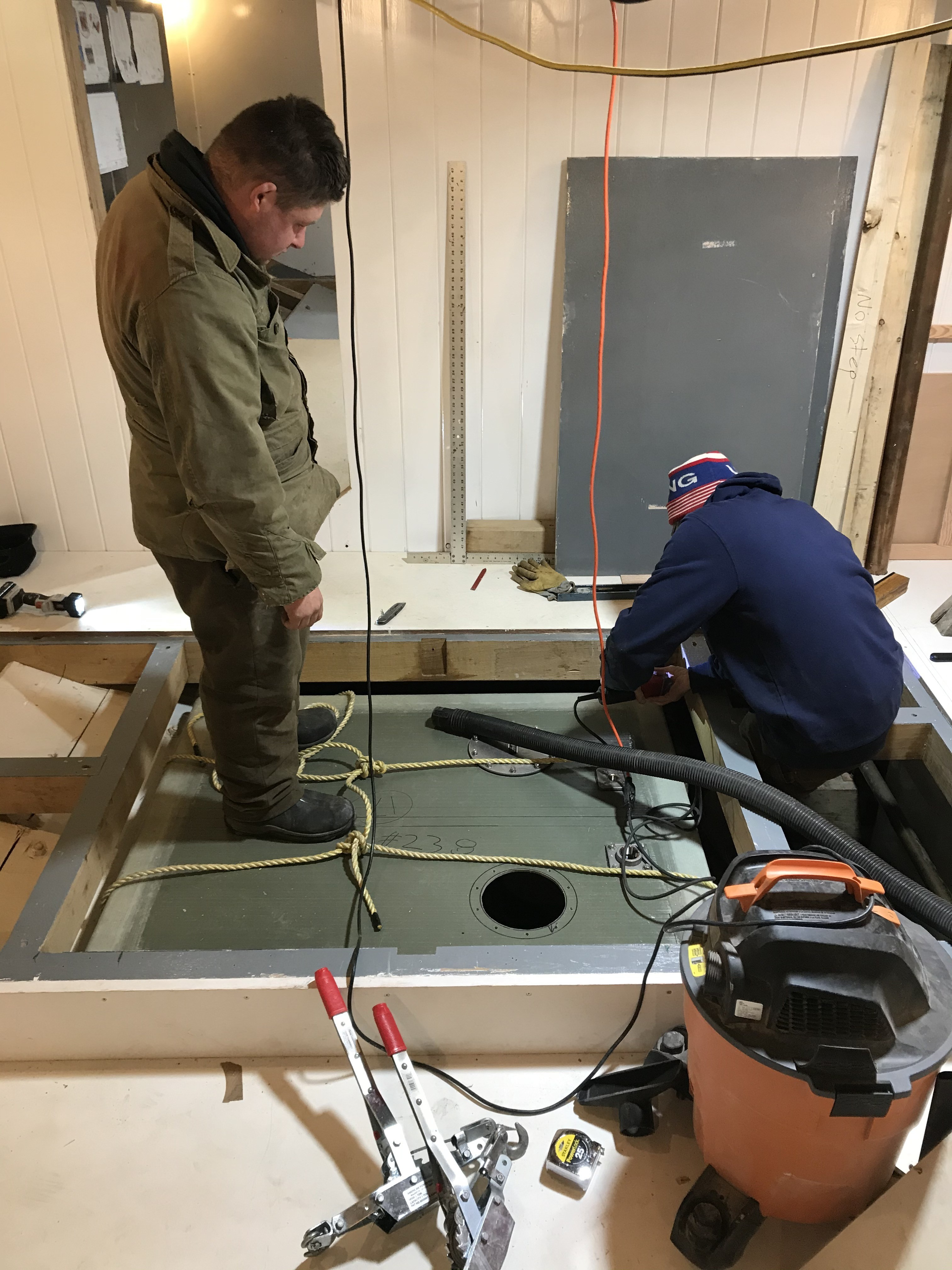 Devon and Mike have carefully loaded all the remaining waste tanks in the ship.  Here, they are installing the starboard side black water tank.  This tank was built of fiberglass by our team at the Shipyard.  We chose fiberglass for it's non-corrosive properties and durability.  These fiberglass tanks are incredibly strong.