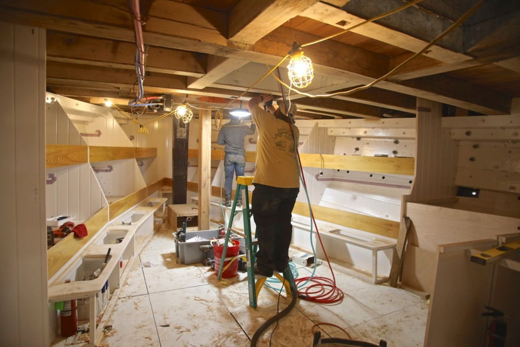 Kevin Danfelser and Jon Brassard have been busy with difficult overhead sanding and painting.  The deck beams in the forward cabin are being finished to match the high quality painted and varnished surfaces throughout the boat.