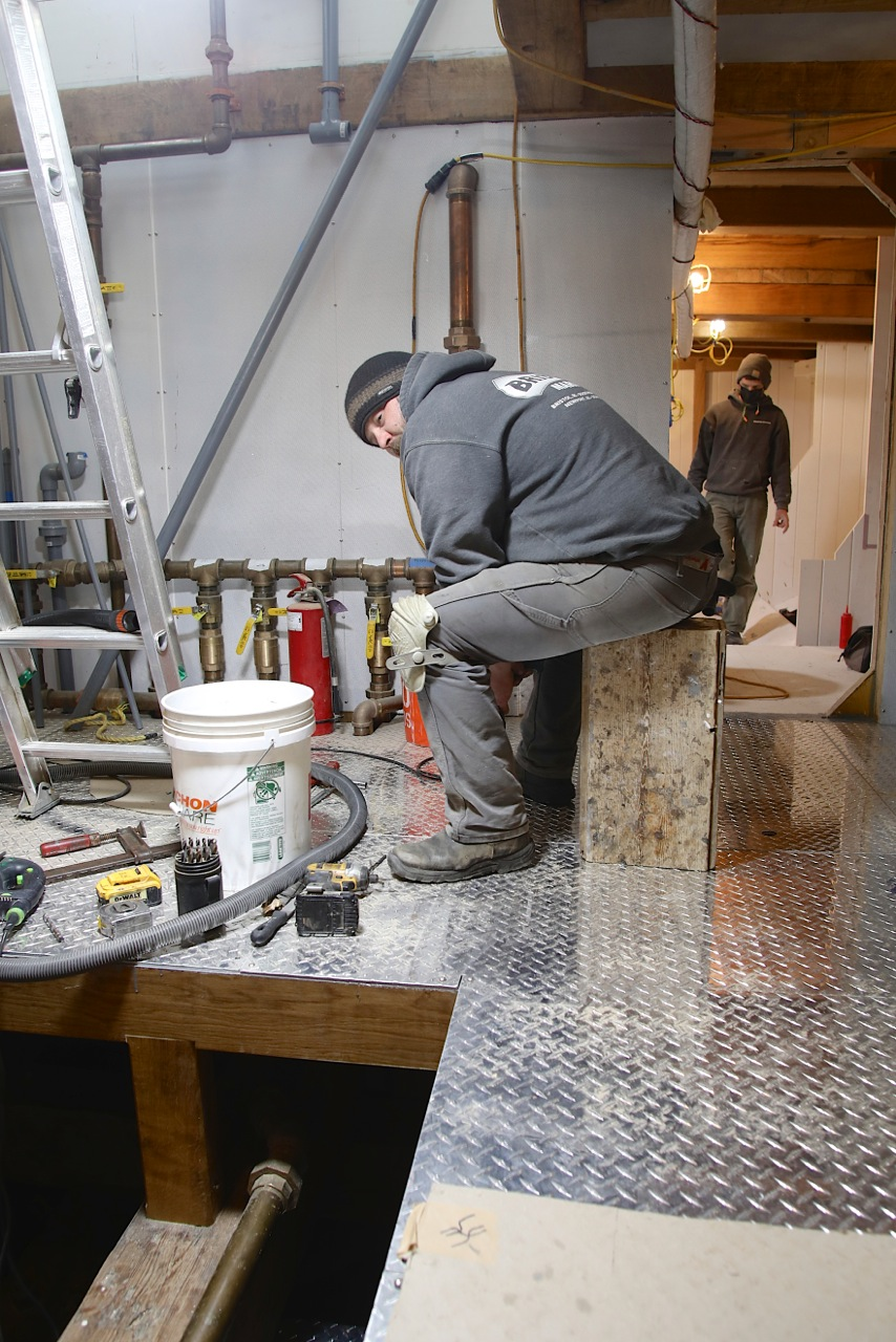 Jason Brassard is not sitting idle.  He is preparing specific areas of the floor for a safety railing that will surround the main engine once it is installed.  In a rough seaway it will be nice to have some strong support to keep safe when operating in and around dangerous machinery.