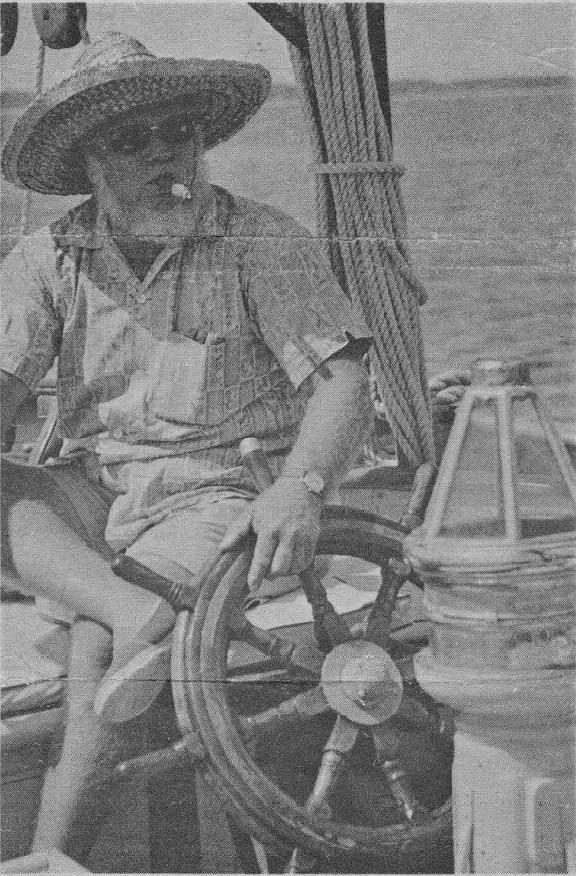 Captain John L. Weeks Jr. at the helm of his 50-foot Alden schooner, Heron